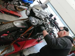 Even a relatively naked bike like the RS, takes an entire day to undertake a major service effectively.