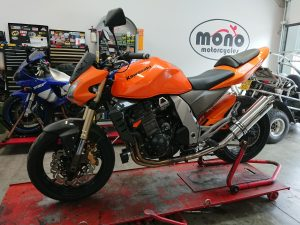 The bright orange Kawasaki Z1000 has returned to the workshop again this week, as she continues her modification journey.